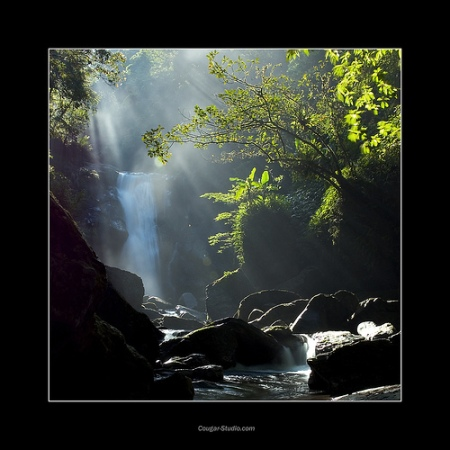 CoverStory-Waterfall with breaking Sunlight